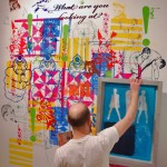 Adam Yothers printing on the wall for the DPI show