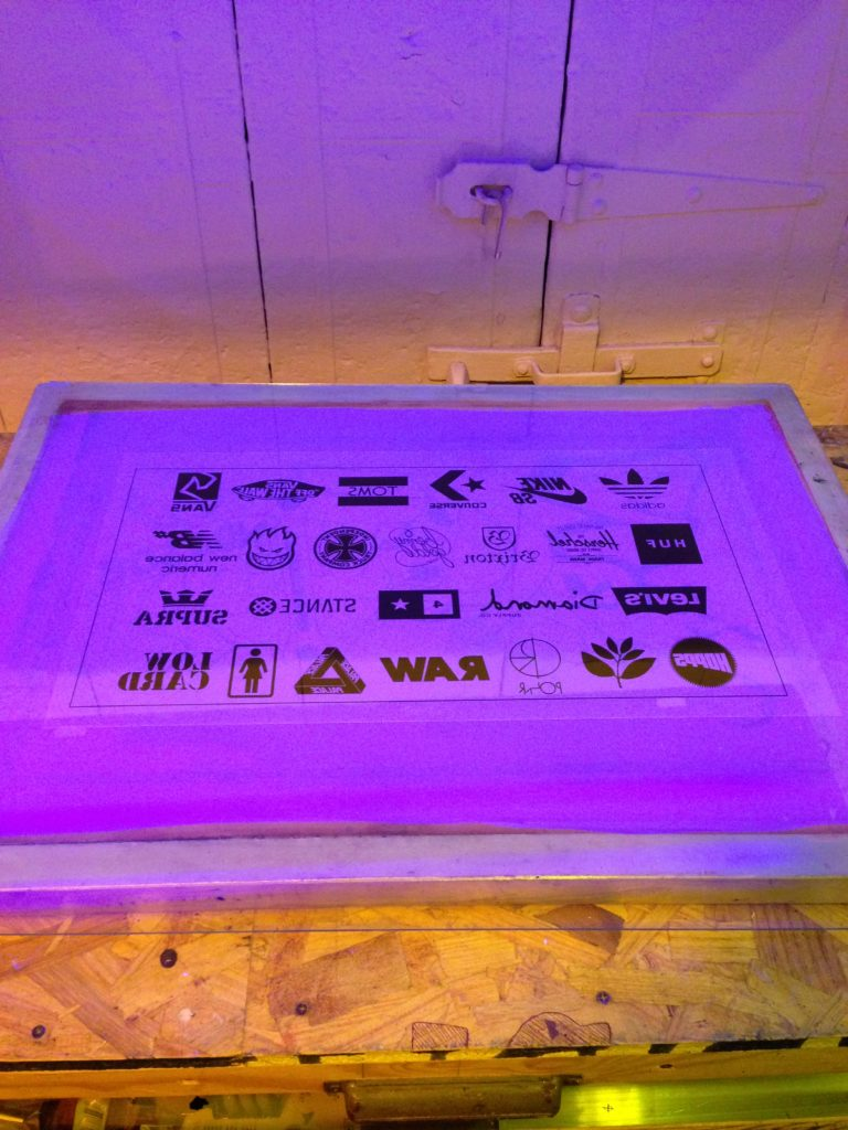 burning the logos for screen printing